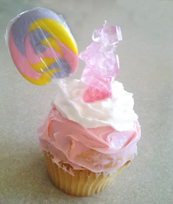 pink cupcake with sucker